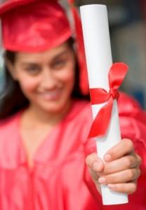 grant vs scholarship, graduate holding her diploma