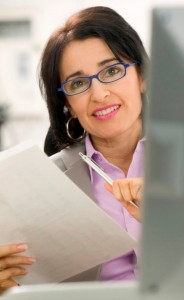 What Are The Federal Pell Grant Requirements? -woman with pen and paper